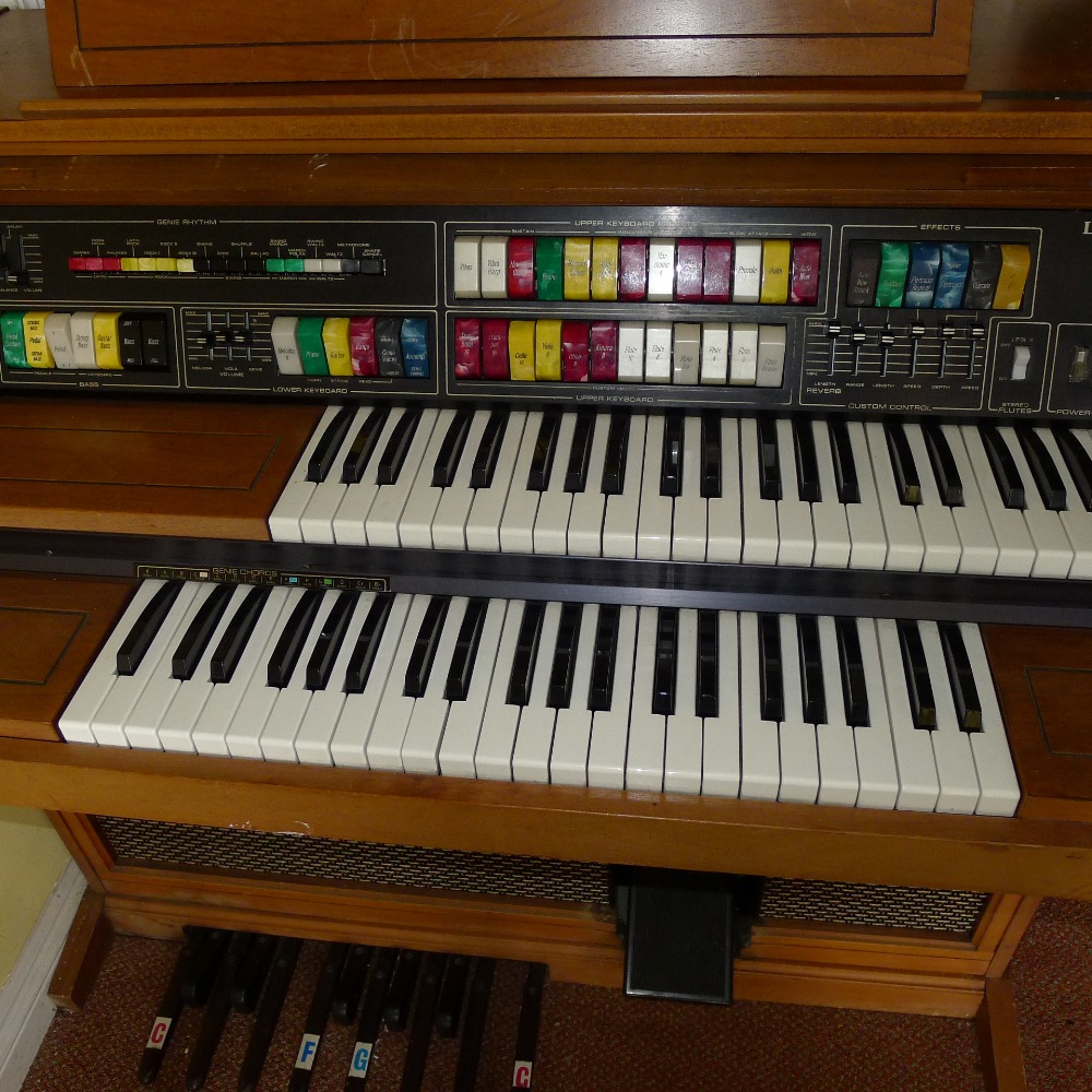 Lot 42 - 1 Lowrey Orchestral Holiday wooden cased electric double keyboard organ (located in nursery area)