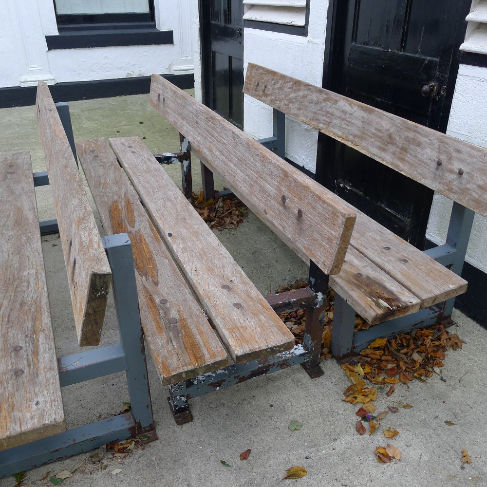 Lot 57 - 1 metal framed timber four seater garden bench (located in front courtyard)