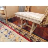 Continental painted and marbleised lamp table the marble top surmounted above four fluted columns