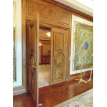 A pair of ornate carved panel doors complete with bronze ironmongery each door 860mm wide x 2330mm