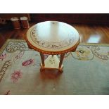 Continental parcel wood centre table 620mm diameter the top with floral motif mounted over three