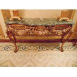 Continental bombe mahogany and console table with a Verde marble top above a carved apron with swags