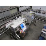 "Safeline metal detector, model SI2000, s/n 2977301, 24 oz, aperture 6""W x 6-1/2""H, with auto reject,"