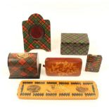 Tartan and other finishes: Six pieces of Mauchline ware, comprising; a cribbage board with tartan