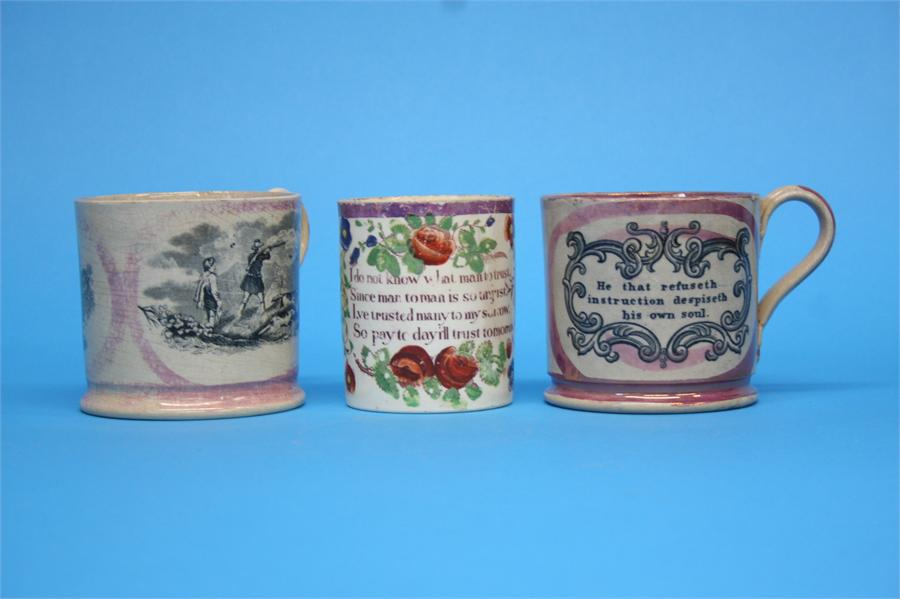 Lot 56 - A Sunderland pink lustre tankard with a hunting scene, two other tankards and a jug. (4)  Each