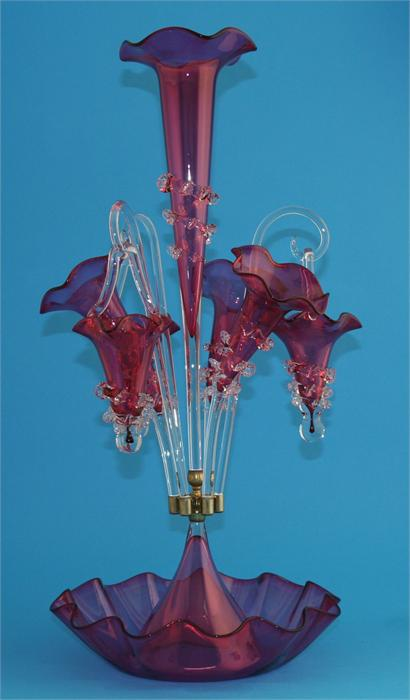 Lot 8 - A modern Victorian style cranberry coloured glass epergne.  60 cm high.