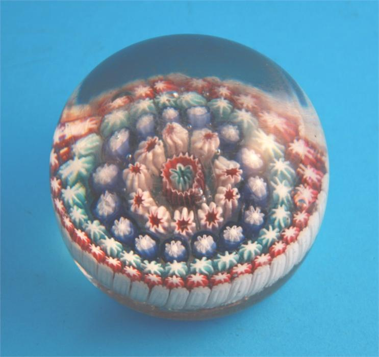 Lot 48 - A Victorian glass millefiori paperweight with central coloured cane and four concentric bands of