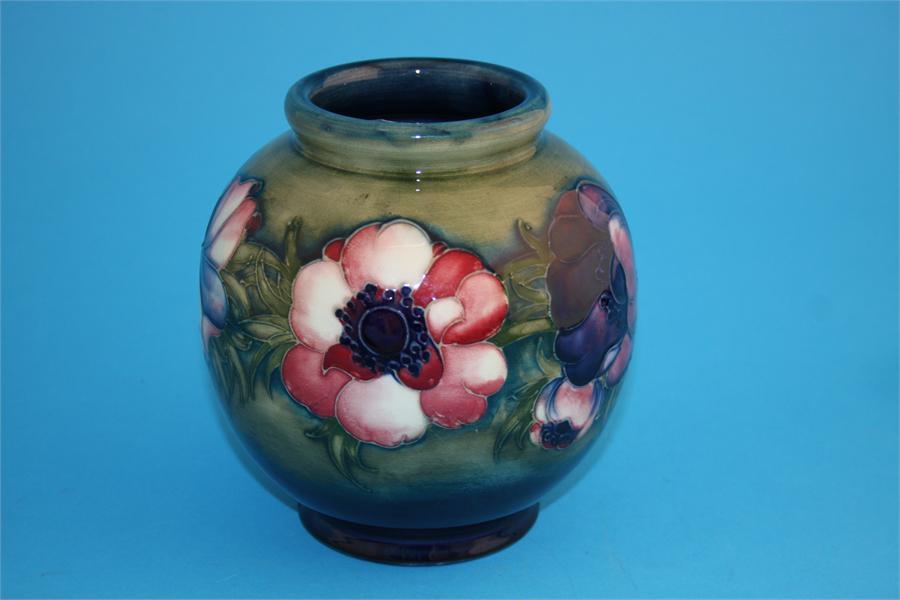 "Lot 25 - A Moorcroft globular shape vase ""Big Poppy"" pattern on a graduated green and blue ground."