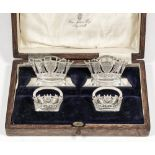 Two pairs of George V silver Naval menu holders cast with various emblems set within crowns, on