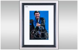 Rory McIlroy Signed Photograph, mounted & signed