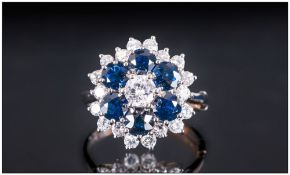 18ct White Gold Set Diamond & Sapphire Dress Ring with flowerhead setting. Excellent white round