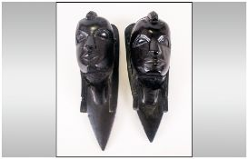 Pair of African Carved Heads In Ebony, Depicting a Man and Woman. 10 Inches High.