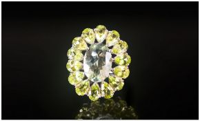 Green Amethyst and Peridot Cluster Ring, a 5ct oval cut green amethyst surrounded by 14 pear cut