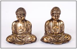 Pair Of Antique Chinese Bronze Buddah Figures in a seated position. Polished. 5'' in height.