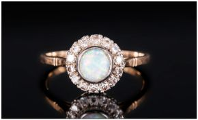 18ct Gold Circular Set Diamond & Opal Ladies Dress Ring, The central & round opal surrounded by 20