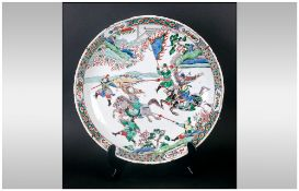 Chinese Famile Verte Charger finely decorated with warring emperors on horseback with attending