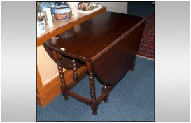 Early 20thC Oak Drop Leaf Table, barley twist supports. Height 28 inches. Table top 42 by 60