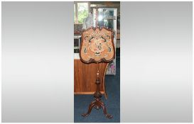 Victorian Rosewood Pole Screen Of Typical Form Turned Column, Raised On A Carved Tripod Base. With