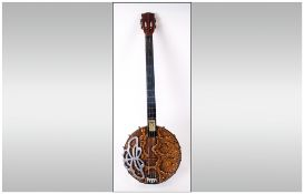 A 1960's 4 String Banjo with Snake Skin and Chrome Fitments. Measures 32 Inches In Length. Good