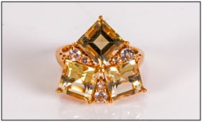 Green Gold Quartz and White Topaz Ring, in trillion style, comprising three square cut natural green