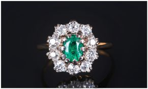 Ladies - 18ct Gold and Platinum Set Emerald and Diamond Cluster Ring. The Emerald of Good Colour,