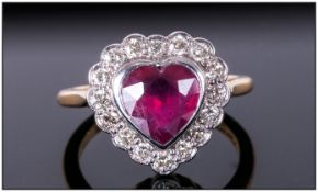 18ct Gold Heart Shaped Ruby & Diamond Ring The heart shaped ruby of good colour surrounded by 16