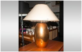 Modern Design Table Lamp Gold tone base with cream shade. 30'' in height.