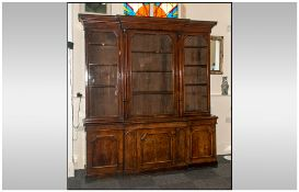 A William IV Fine Pollard Oak Breakfront Library Bookcase Circa 1835. The upper section with a