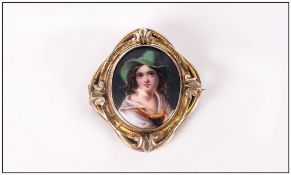 Antique Painted Porcelain Oval Shaped Brooch, Depicting a Young Girl Wearing a Hat, Enclosed In a