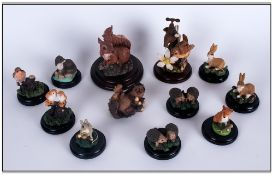 Collection Of 11 Miniature Animal Figures On Bases Together With A Hedgehog