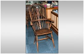 19thC Windsor Chair in ash and elm, of typical form. Spindled back with pierced splat.