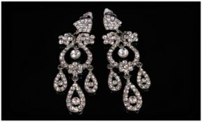 Crystal Chandelier Clip-On Statement Earrings, a pair of multi drop and loop white crystal glamorous