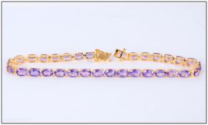 Purple Amethyst Tennis Bracelet, 12.75cts of oval cut amethyst set in a gold vermeil and silver