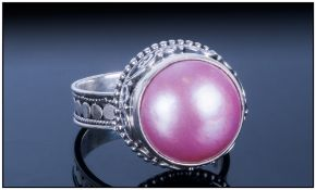 Pink Fresh Water Mabe Pearl Ring, the 14mm solitaire pearl which has developed with a flat underside