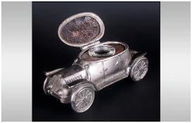 German Silver Plated Inkwell, in the form of a car, with a hinged lid exposing a glass inkwell.