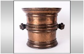 Early Bronze Mortar With a Ribbed Body, With Hands Carrying Handles, 17th Century. Height 6.5