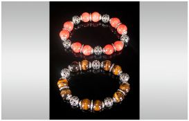 Set of Two Gemstone Bracelets, one of tiger eye round beads with openwork caps and spacers, the