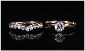 Ladies 9ct Gold Set C.Z Dress Rings, 2 in total. One single stone ring. The other 1/2 eternity ring.