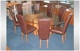 Contemporary Design Table & Eight Chairs, Large Oval Glass Topped Dining Table Raised On A