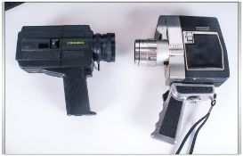 2 Hard Cased Cine Cameras with instructions.