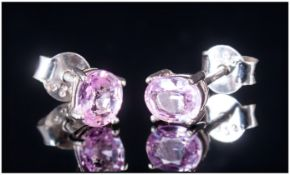 Pink Sapphire Stud Earrings, two solitaire oval cut pink sapphires totalling .75ct, set in rhodium