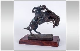 Frederic Remington Franklin Mint Bronze Sculpture Titled 'The Brono Buster' Circa 1988. Raised On
