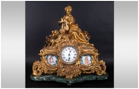 French 19th Century Ormalu Serves Mounted Mantle Clock in the rococo style. The two panels decorated