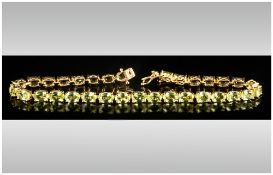Peridot Tennis Bracelet, oval cut peridots totalling 15cts set in gold vermeil and silver in a