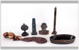Six Ethnic Wood Carvings Consisting Of An Oval Bowl, carved native head, two totems, club, lidded