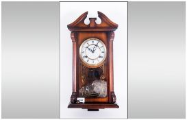Severals 31 Day Wooden Cased Wall Clock, Porcelain dial with roman numerals. 21'' in height