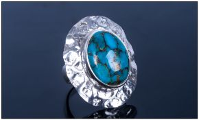 Mojave Turquoise Ring, an oval cut cabochon of the turquoise, mined in the Mojave Desert, USA, 7.