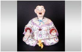German Porcelain Nodding Buddah Figure In A Sitting Gesture, when the head is touched it rocks on