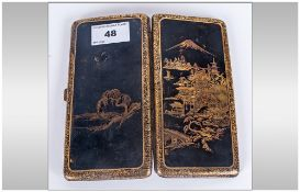 Japanese Black Lacquered Cigarette Case, gold decoration. The hinged front showing pagodas with
