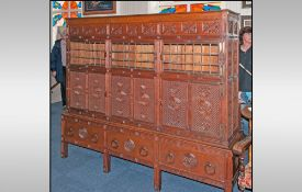 A Rare Aesthetic Movement Highly Carved Cabinet Cupboard In Oak. The top has three leaded top
